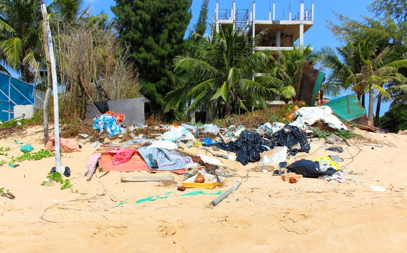 Pollution on the beach of tropical sea stock photography