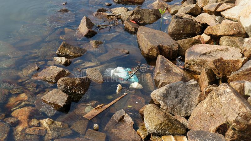 Pollution of coastal ecosystems, natural plastic and beaches stock photos