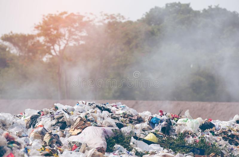 Pollution concept. Garbage pile in trash dump or landfill. Garbage dump stock photography