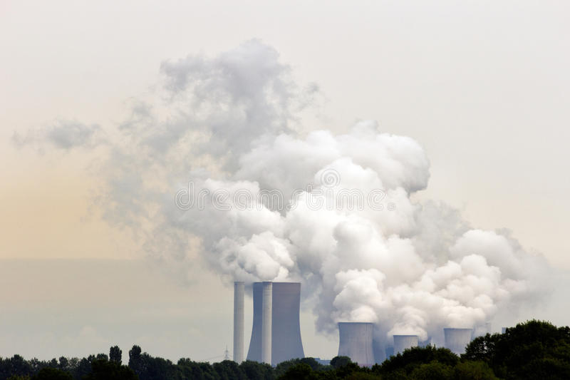 Pollution emission. Brown coal fuel power station emission royalty free stock photos