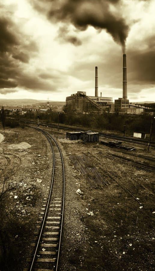 Pollution from power plant near train rail stock photos