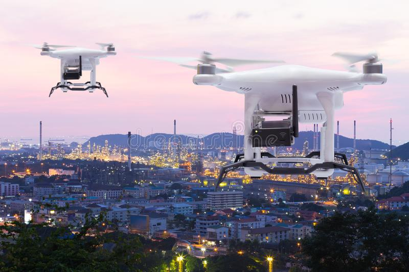 Pollution sensor drone flying to survey on industry zone royalty free stock photography