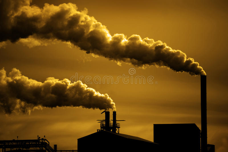 Pollution and Smoke from Chimneys of Factory or Power Plant royalty free stock photo