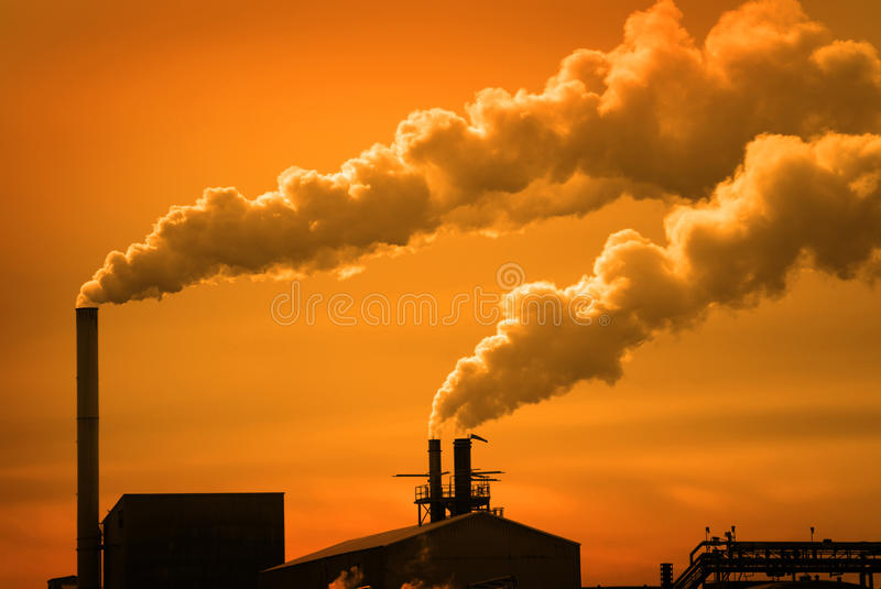 Pollution and Smoke from Chimneys of Factory or Power Plant royalty free stock photos