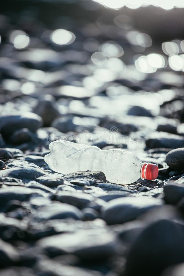 Environmental pollution: plastic bottle on the beach. Pollution waste plastic environmental protect bottle litter cleanup garbage trash sea beach pvc pet eco stock images