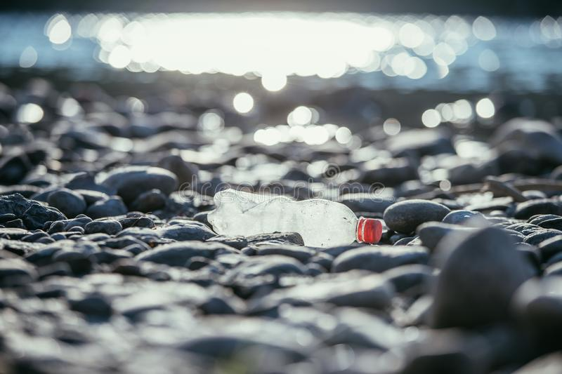 Environmental pollution: plastic bottle on the beach. Pollution waste plastic environmental protect bottle litter cleanup garbage trash sea beach pvc pet eco stock photos