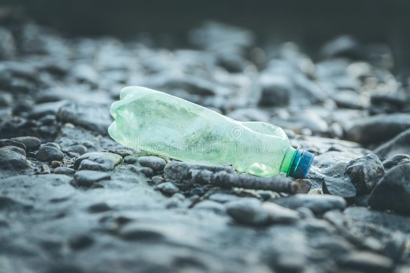 Environmental pollution: plastic bottle on the beach. Pollution waste plastic environmental protect bottle litter cleanup garbage trash sea urban beach pvc pet stock image