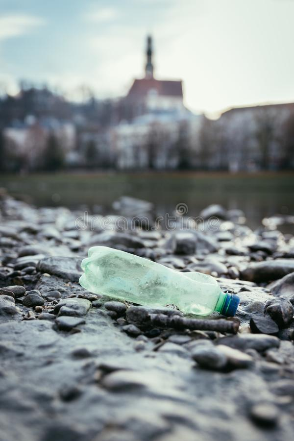 Environmental pollution: plastic bottle on the beach, urban city. Pollution waste plastic environmental protect bottle litter cleanup garbage trash sea urban royalty free stock photography