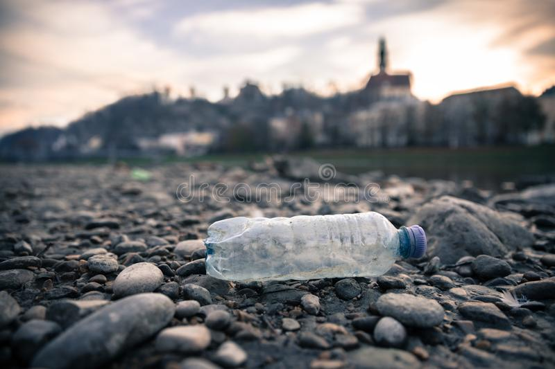 Environmental pollution: plastic bottle on the beach, urban city. Pollution waste plastic environmental protect bottle litter cleanup garbage trash sea urban royalty free stock images