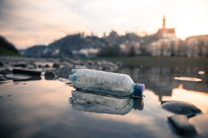 Environmental pollution: plastic bottle on the beach, urban city. Pollution waste plastic environmental protect bottle litter cleanup garbage trash urban water stock photo