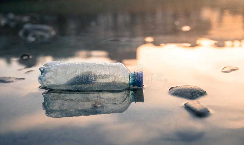 Environmental pollution: plastic bottle on the beach. Pollution waste plastic environmental protect bottle litter cleanup garbage trash urban water sea beach stock photos