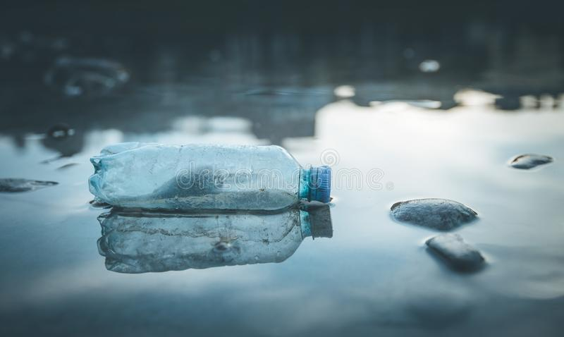 Environmental pollution: plastic bottle on the beach. Pollution waste plastic environmental protect bottle litter cleanup garbage trash urban water sea beach stock images