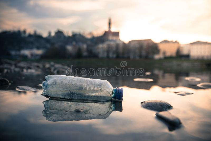Environmental pollution: plastic bottle on the beach, urban city. Pollution waste plastic environmental protect bottle litter cleanup garbage trash urban water stock image