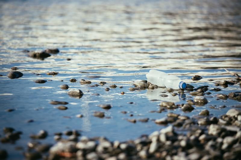 Environmental pollution: plastic bottle on the beach stock photo