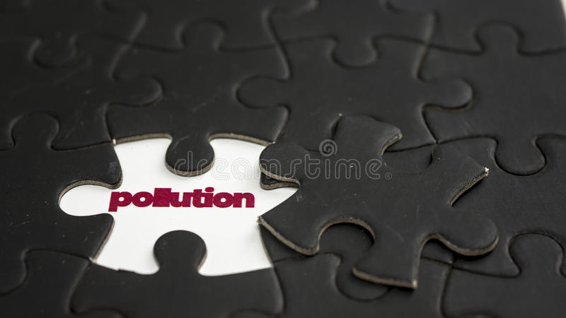 Pollution. Word pollution under jigsaw puzzle piece stock images