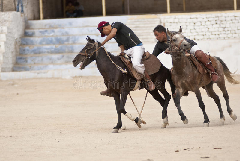 Polo Match. Men playing polo on a barren dusty pitch in Leh, capital of Ladakh, India. Despite this match being played at an altitude of over 3,000 meters, it stock photo