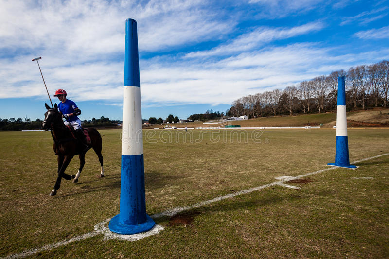 Polo Rider Goals Field Blue. Polo field with Rider horse pony past goal posts stock photo