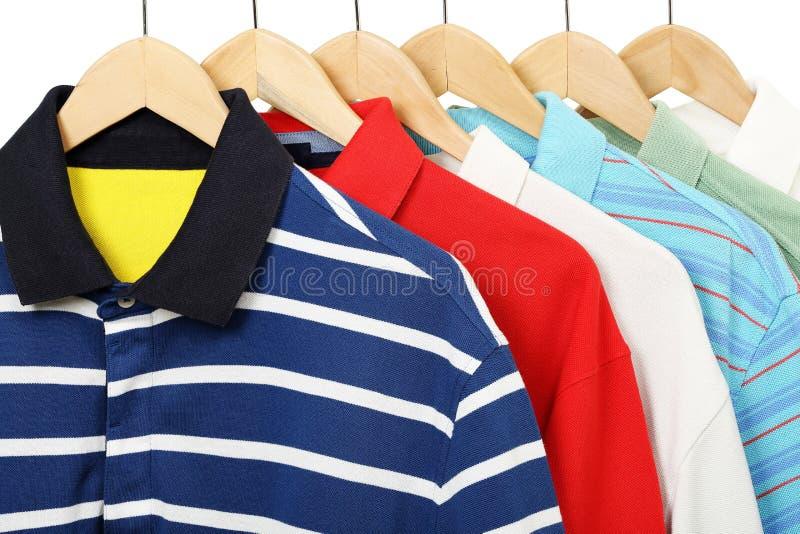 Polo shirts. Colorful polo shirts on hangers stock photography