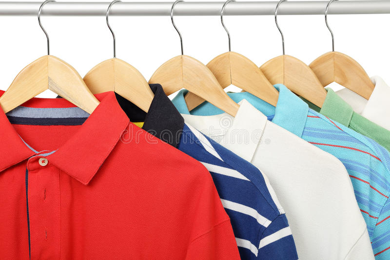 Polo shirts. Colorful polo shirts on hangers royalty free stock photos