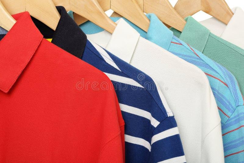 Polo shirts. Colorful polo shirts on hangers closeup royalty free stock photography