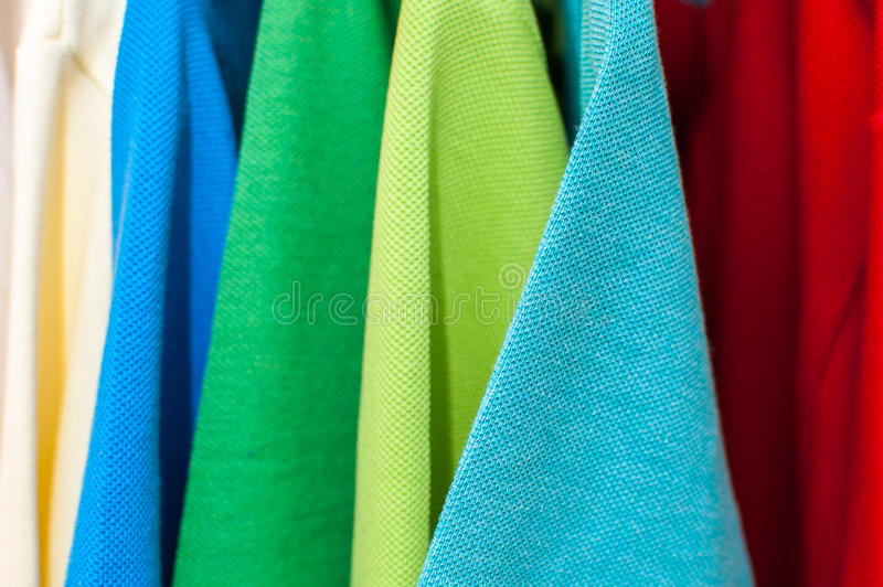Polo shirts. Luxurious fine material 100% cotton polo shirts in various colors on hangers stock image