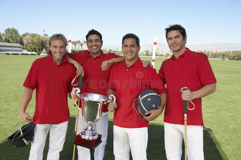 Polo Team With Trophy imagem de stock royalty free