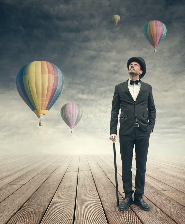 Polotny rocznika biznesmen z gorące powietrze ballons fotografia royalty free