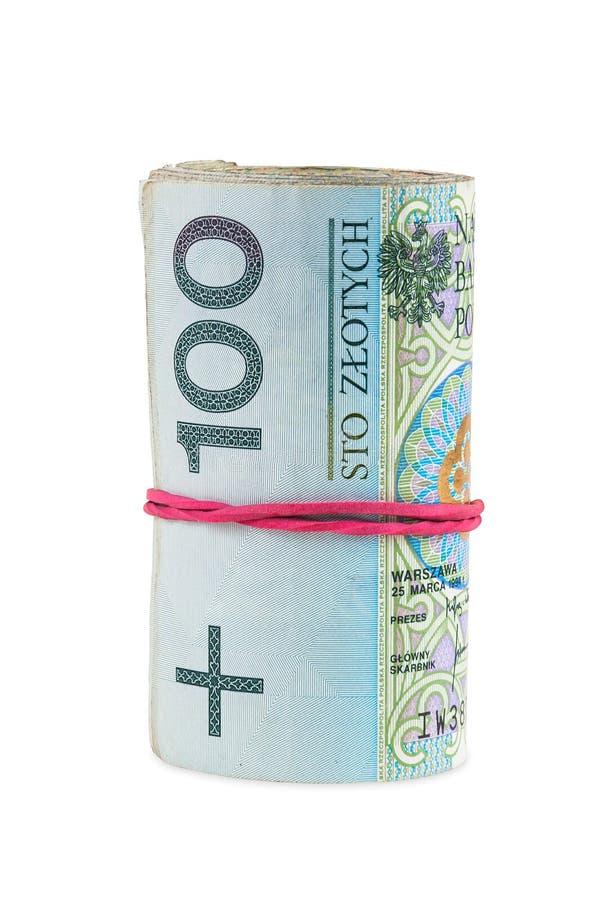 Polscy banknoty 100 PLN staczających się z gumą fotografia stock