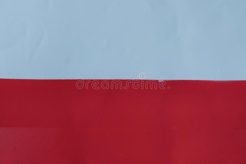 Polsk flagga som målas med sprutmålningsfärg fotografering för bildbyråer