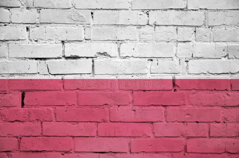 Polska flaga maluje na starym ściana z cegieł obrazy stock