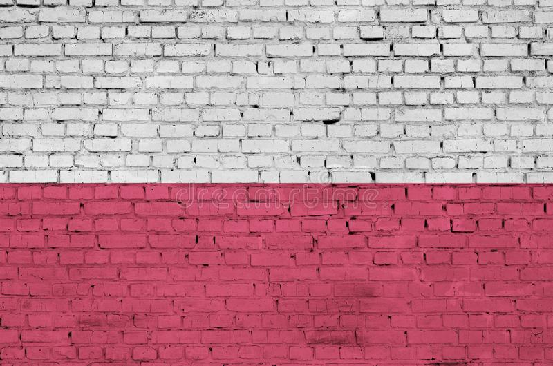 Polska flaga maluje na starym ściana z cegieł zdjęcie royalty free