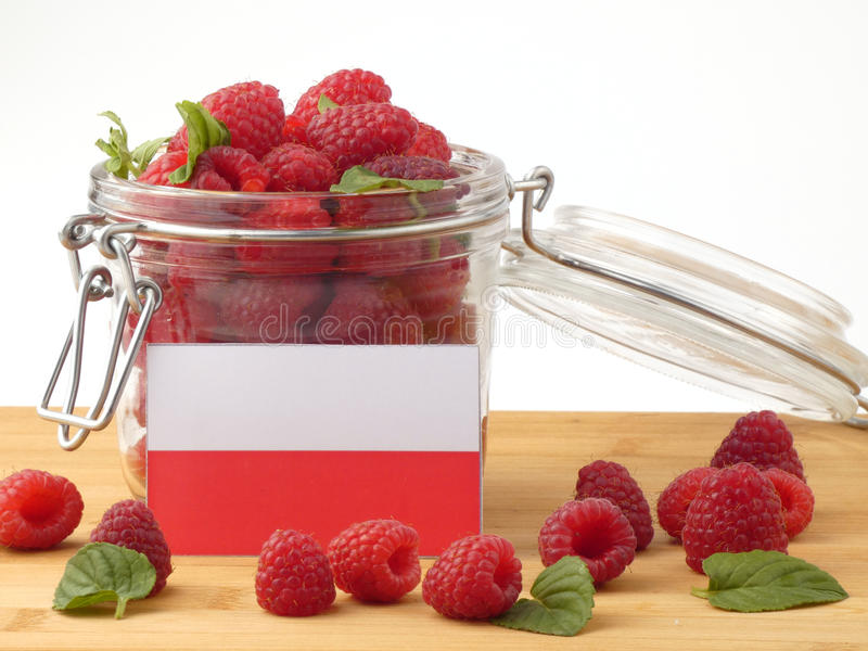 Polska flaga na drewnianym panelu z malinkami odizolowywać na whi zdjęcia royalty free