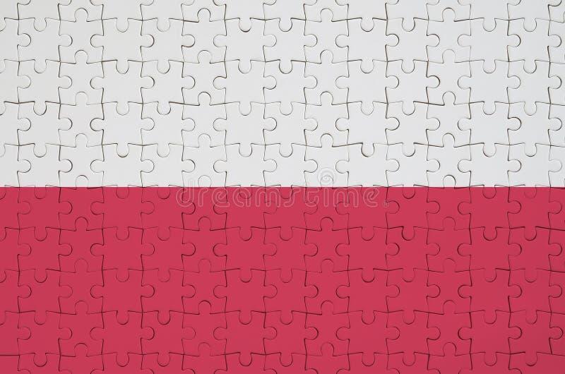 Polska flaga przedstawia na fałdowej łamigłówce obrazy stock