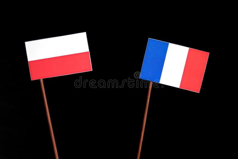 Polska flaga z francuz flaga na czerni zdjęcia stock