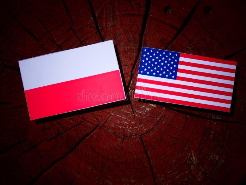 Polska flaga z usa flaga na drzewnym fiszorku obrazy royalty free
