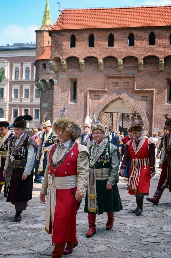 Polska ludowa spółdzielnia na głównym placu przy podczas barbakanu w Krakow, Polska głównego placu rynek w Krakow, obok Mariacki  zdjęcie royalty free