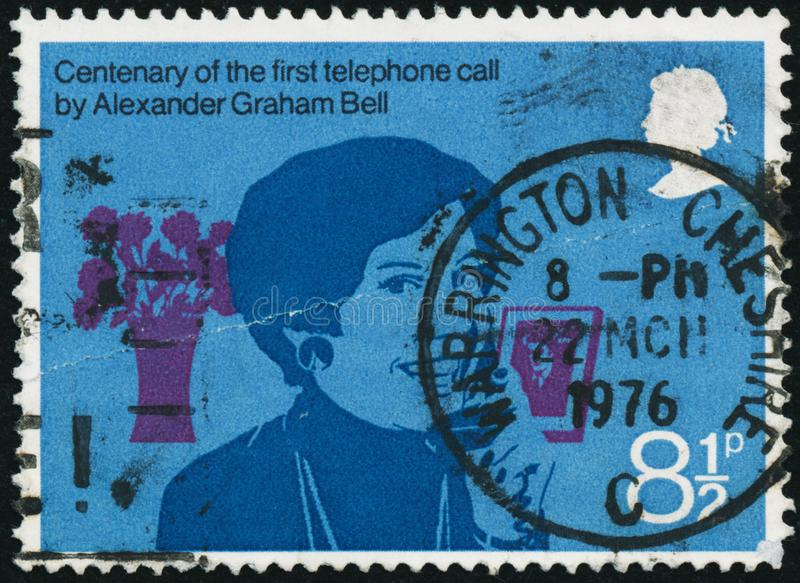 Vintage stamp printed in Great Britain 1976 shows the 100th Anniversary of the First Telephone call by Bell stock image