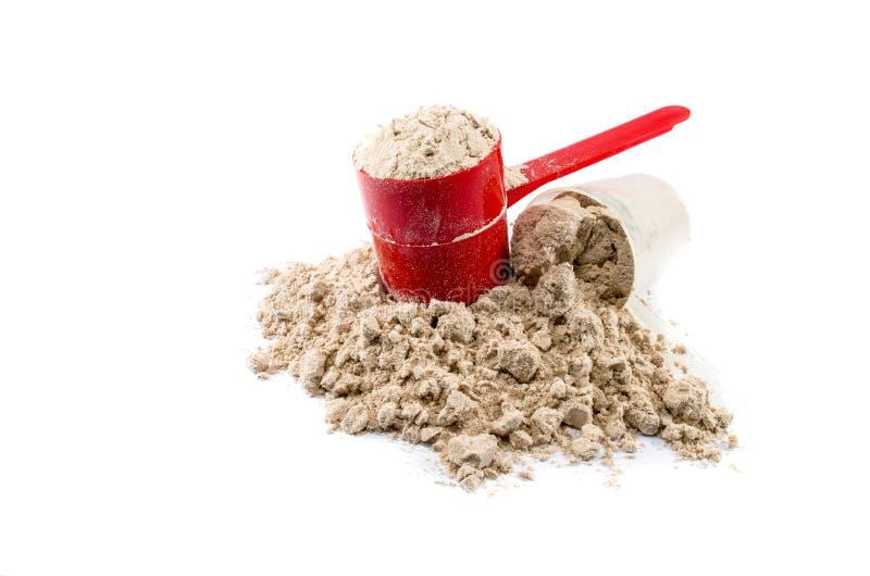 Polvere del proteina del siero immagini stock