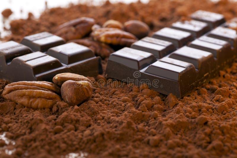 Polvere della barra e di cacao di cioccolato fotografia stock