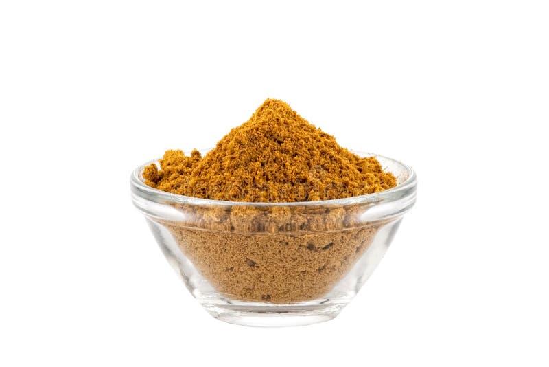 Polvere di curry calda di Madras in ciotola di vetro immagini stock