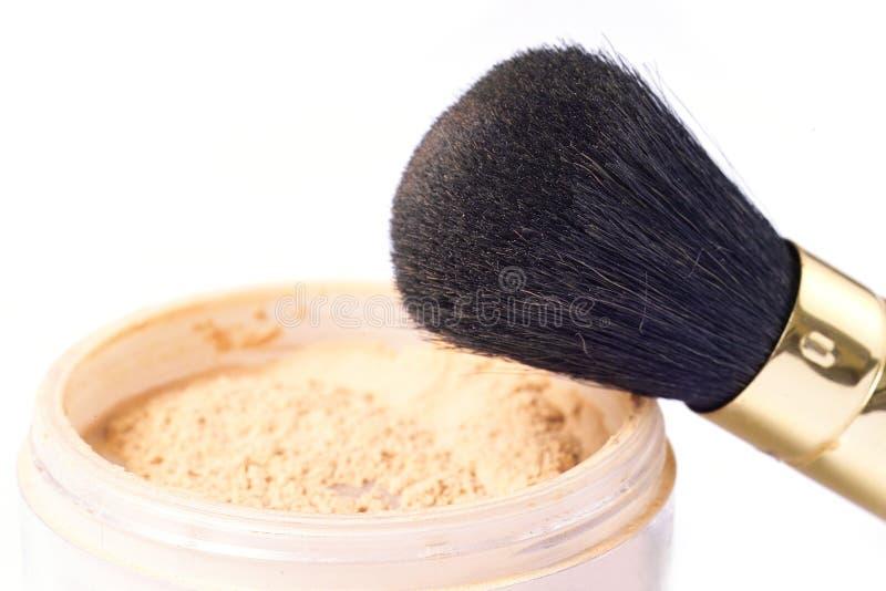 Polvere e spazzola fotografie stock