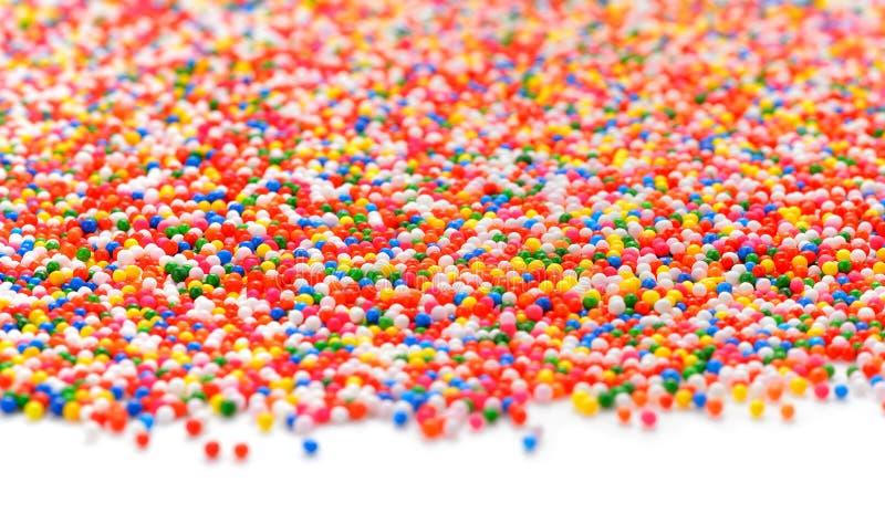 Polvilhar-arco-íris colorido do açúcar colorido imagem de stock