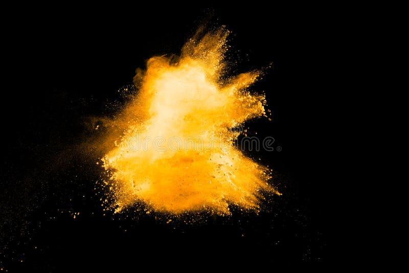 Polvo anaranjado abstracto salpicado en fondo oscuro fotografía de archivo