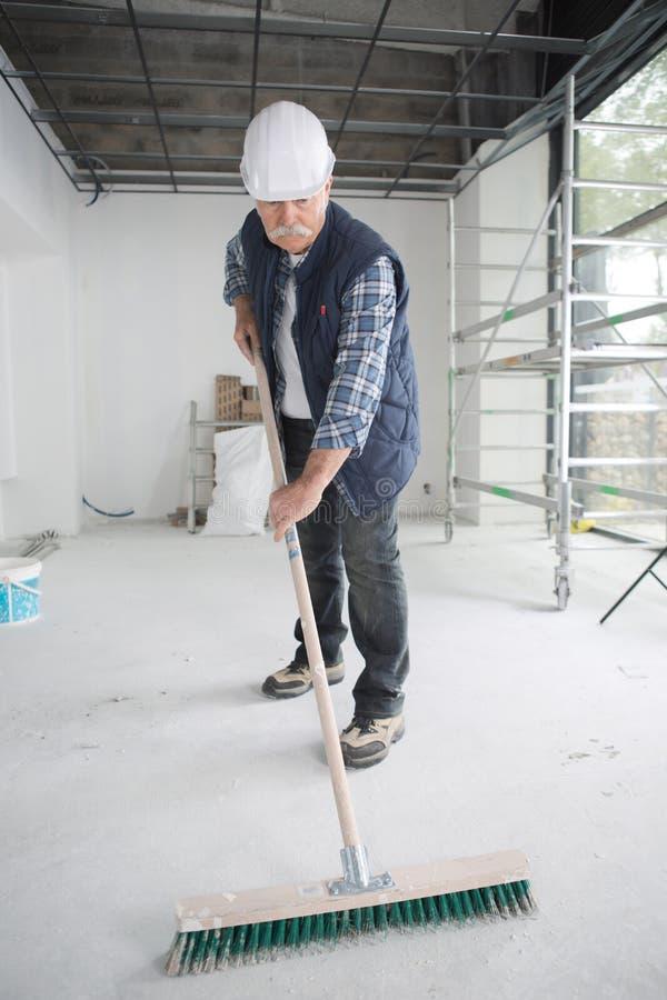 Polvo arrebatador del piso foto de archivo