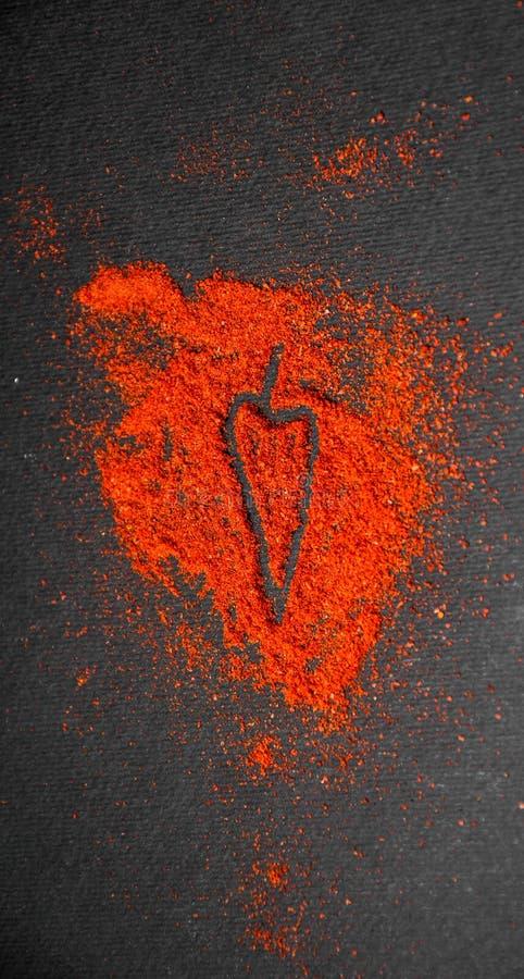 Polvo de chile con el símbolo fotos de archivo