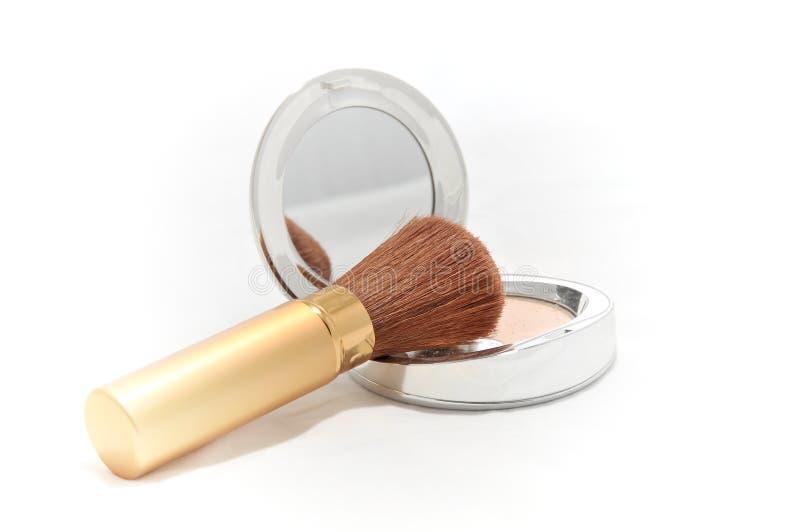 Polvo del maquillaje con el cepillo fotografía de archivo