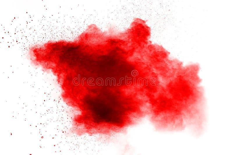 Polvo rojo abstracto salpicado en el fondo blanco Explosi?n roja del polvo Movimiento del helada del chapoteo rojo de las part?cu fotografía de archivo libre de regalías