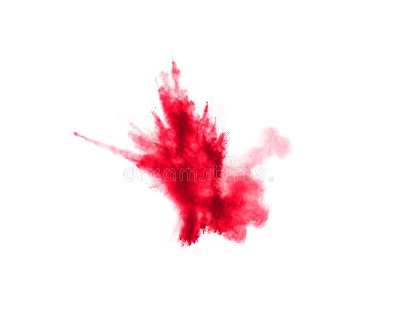 Polvo rojo abstracto salpicado en el fondo blanco Explosi?n roja del polvo Movimiento del helada del chapoteo rojo de las part?cu foto de archivo libre de regalías