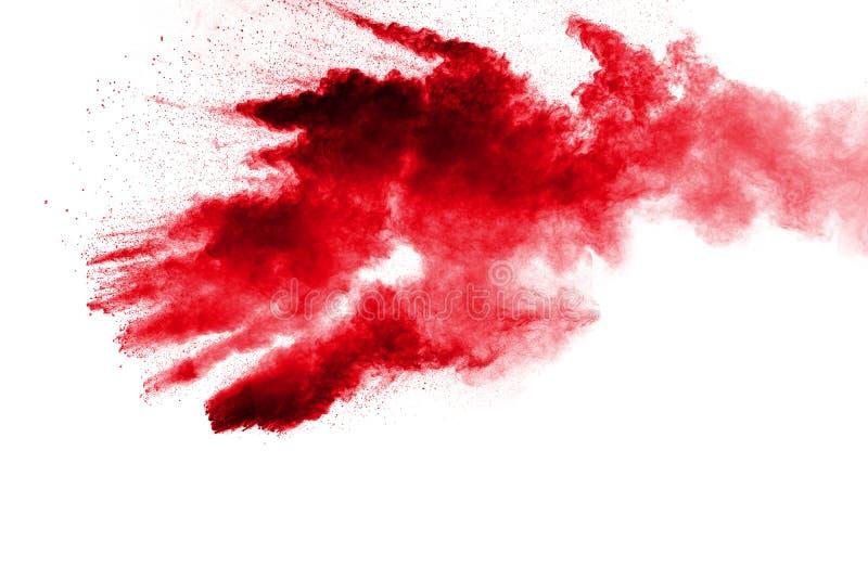 Polvo rojo abstracto salpicado en el fondo blanco Explosi?n roja del polvo Movimiento del helada de salpicar rojo de las part?cul foto de archivo libre de regalías