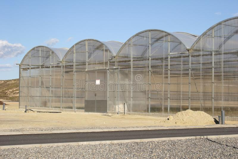 Poly-carbonate multi tunnel type greenhouses in Spain. Very high greenhouses for long term cultivation royalty free stock image
